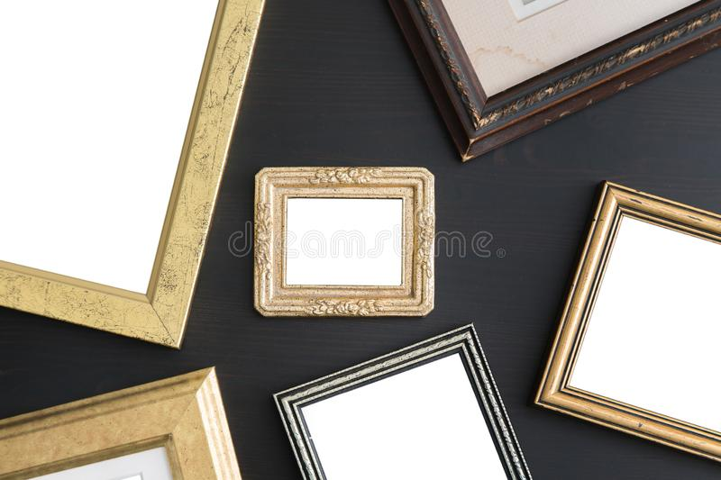 Blank empty frames on dark wooden background. Art gallery, museum exhibition white clipping path royalty free stock photo