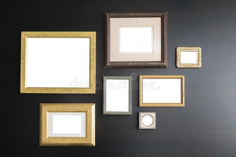 Blank empty frames on dark wooden background. Art gallery, museum exhibition white clipping path stock photo