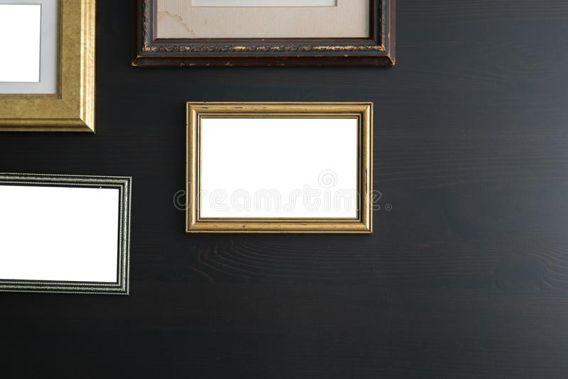 Blank empty frames on dark wooden background. Art gallery, museum exhibition white clipping path stock photography