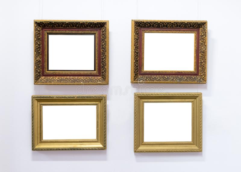 Blank empty frames hanging on museum wall. Art gallery, museum exhibition white clipping path stock photography