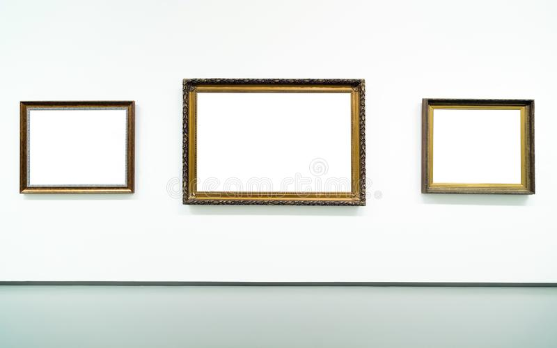 Blank empty golden frame on white background. Art gallery, museum exhibition white clipping path royalty free stock image
