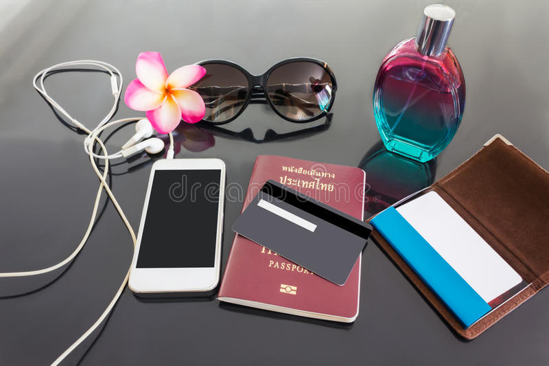 Blank or empy credit or debit card and smartphone with background of perfume, sunglasses, flower ,blank business card and passport stock photos