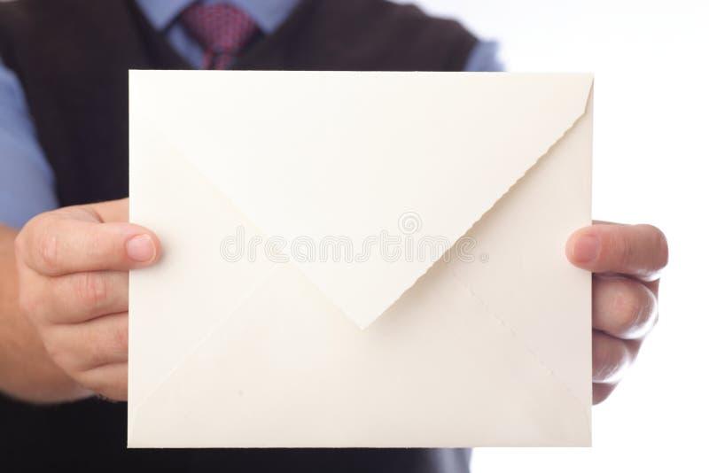 Blank envelop in a hand