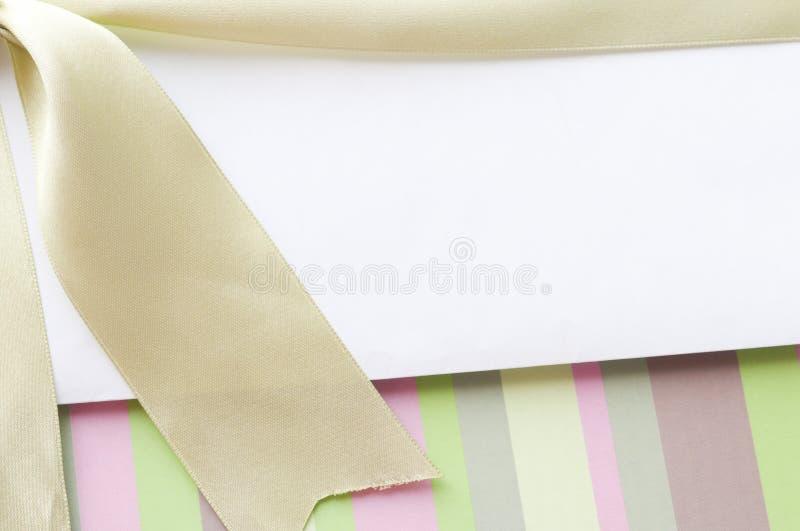 Blank envelope on the gift box stock image