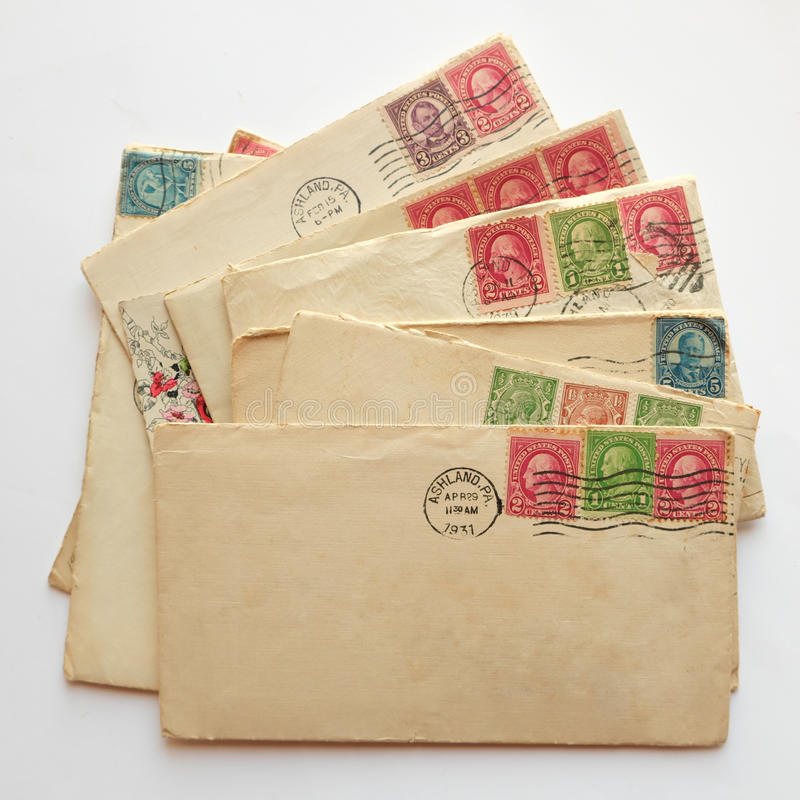 Blank envelope on pile of old letters, envelopes post stamps royalty free stock images