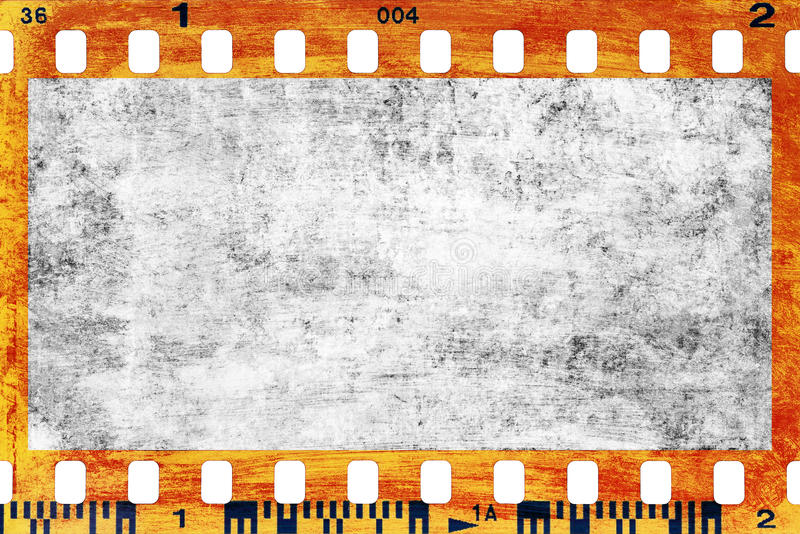 Blank filmstrip. Closeup of grungy filmstrip for backgrounds or designs stock image