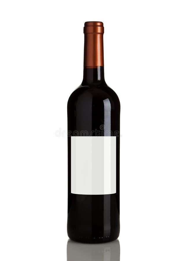 blank flasketikettrött vin royaltyfri bild