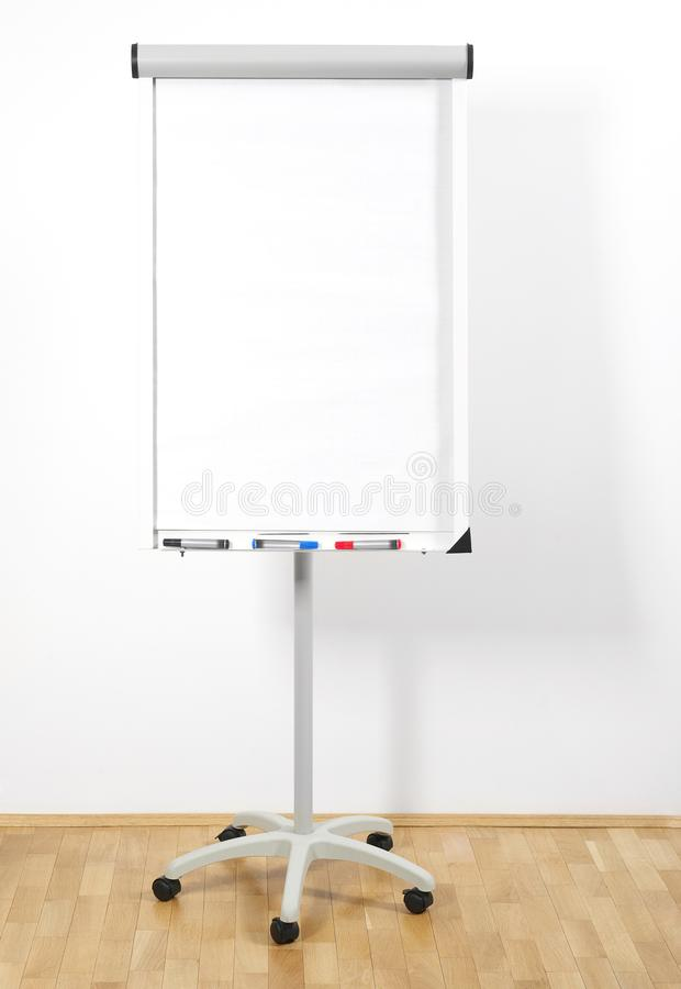 Flip chart. Blank flip chart in room royalty free stock image