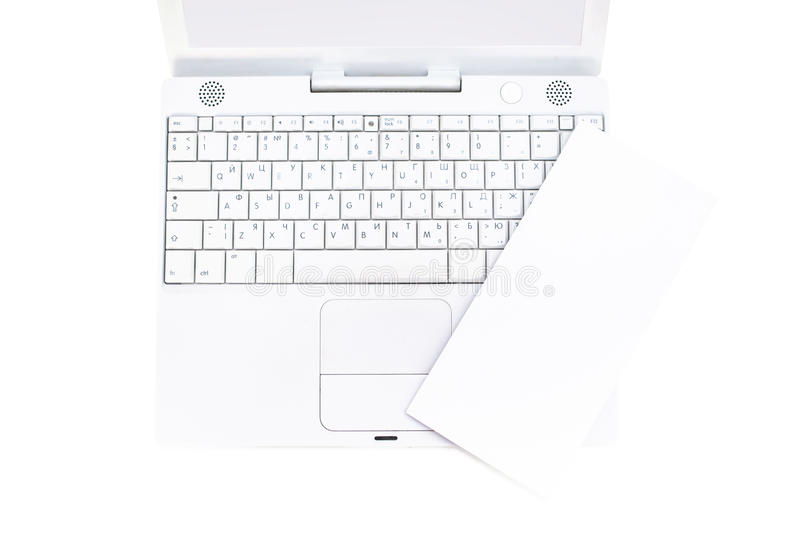 Blank flyer on laptop. Blank flyer on notebook isolated on white, high angle view stock image