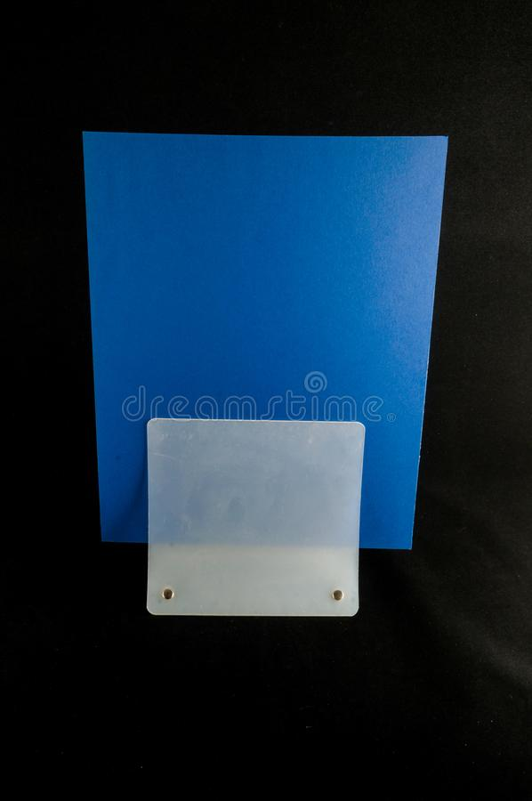 Blank flyer mockup paper holder isolated. Plain flier stand Clear brochure holding stock image