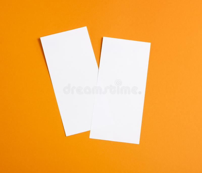 Blank flyer over orange background to replace your design. Blank flyer over orange background to replace your design stock photo