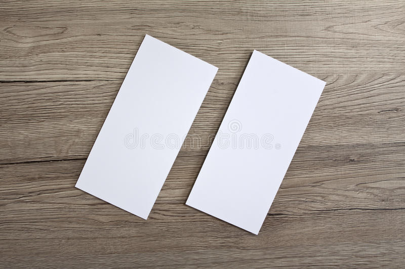 Blank flyer over wooden background to replace your design. Blank flyer over wooden background to replace your design stock photography