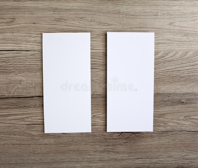 Blank flyer over wooden background to replace your design. Blank flyer over wooden background to replace your design royalty free stock images