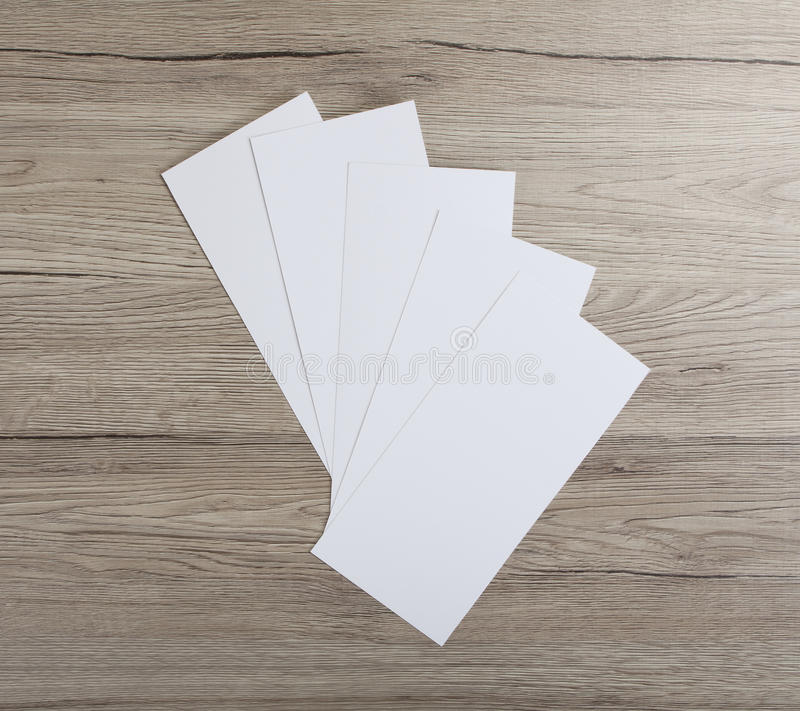 Blank flyer over wooden background to replace your design. Blank flyer over wooden background to replace your design stock image