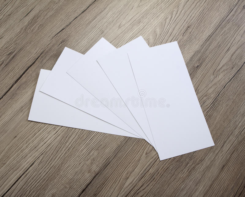 Blank flyer over wooden background to replace your design. Blank flyer over wooden background to replace your design royalty free stock photography