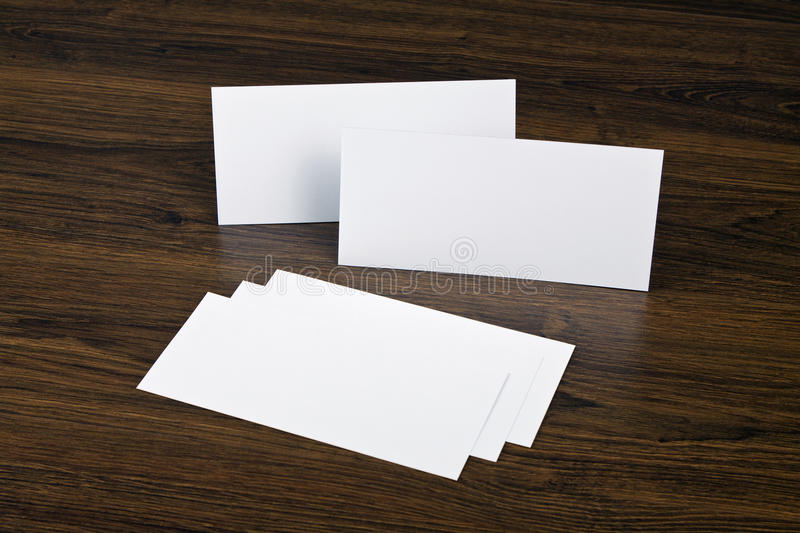 Blank flyer over wooden background to replace your design. Blank flyer over wooden background to replace your design royalty free stock image