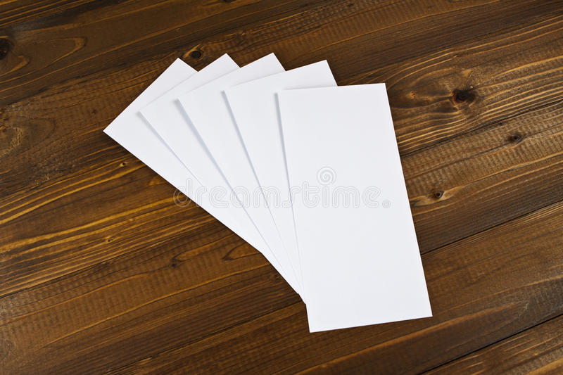 Blank flyer over wooden background to replace your design. Blank flyer over wooden background to replace your design stock images
