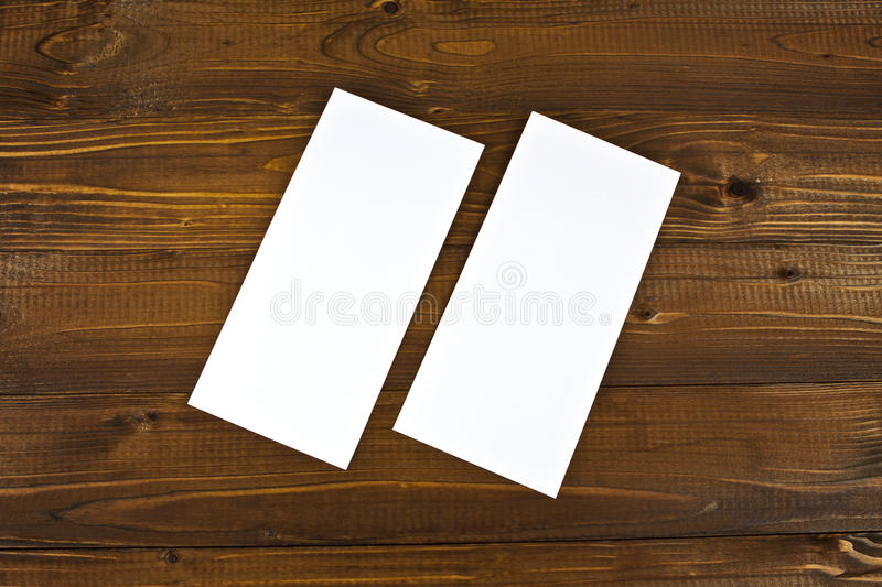 Blank flyer over wooden background to replace your design. Blank flyer over wooden background to replace your design royalty free stock photo