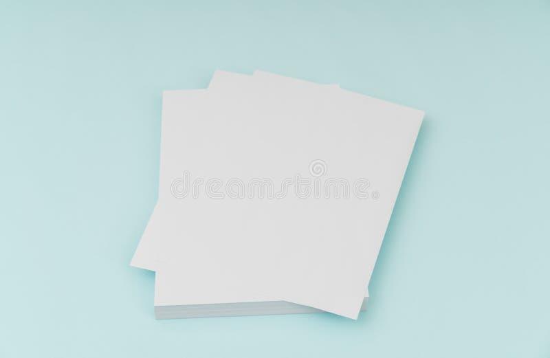 Blank flyer poster, brochure mockup,A4, US-Letter, on blue background . Blank flyer poster, brochure mockup,A4, US-Letter, on blue background stock photography
