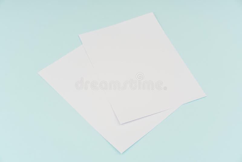 Blank flyer poster, brochure mockup,A4, US-Letter, on blue background . Blank flyer poster, brochure mockup,A4, US-Letter, on blue background royalty free stock images