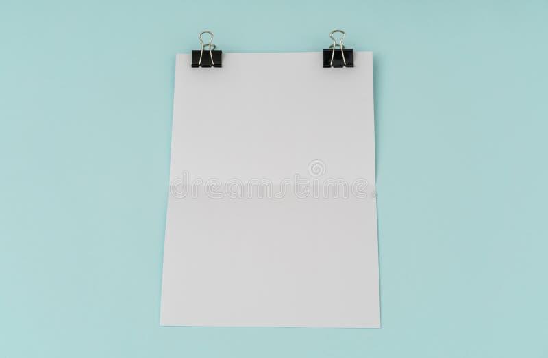 Blank flyer poster, brochure mockup,A4, US-Letter, on blue background . Blank flyer poster, brochure mockup,A4, US-Letter, on blue background stock photo