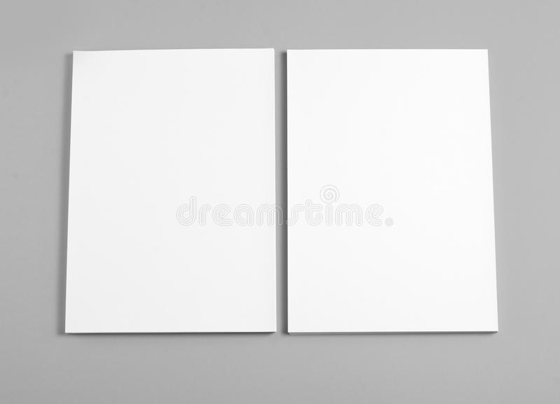 Blank flyer poster on grey background to replace your design. Blank flyer poster on grey background to replace your design stock photography