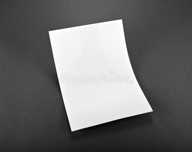 Blank flyer poster on grey to replace your design. Blank flyer poster on grey to replace your design royalty free stock images