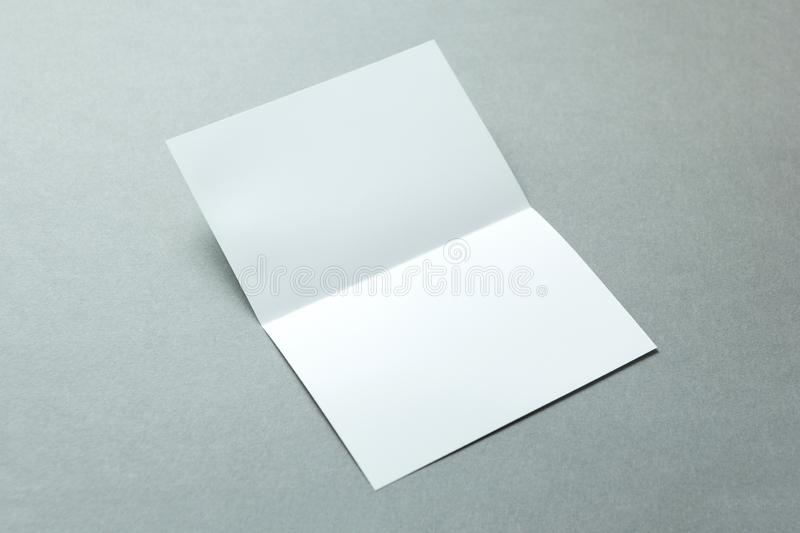 Blank flyer poster isolated on grey background to replace your design. Mockup.  royalty free stock photo