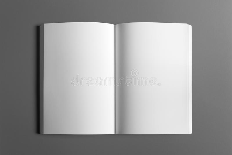 Blank flyer poster isolated on grey royalty free stock photo
