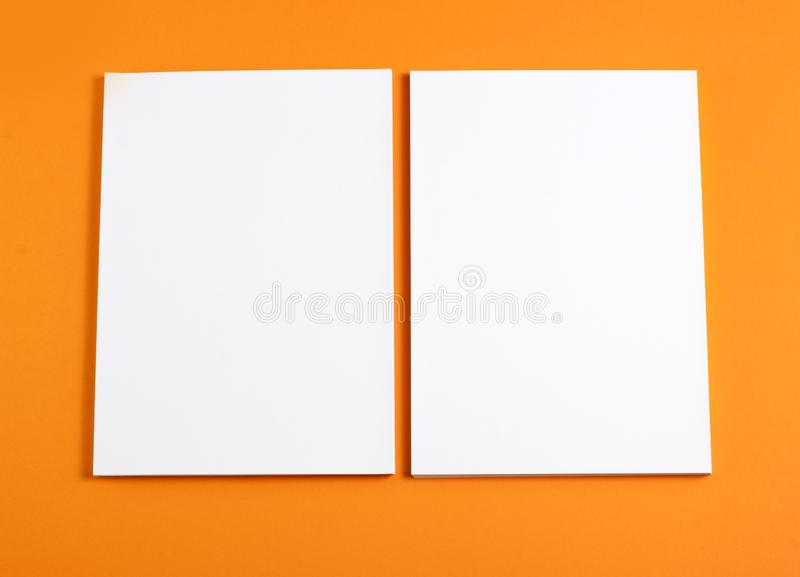 Blank flyer poster on orange background to replace your design. Blank flyer poster on orange background to replace your design royalty free stock photography