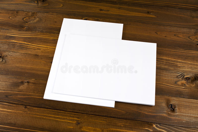 Blank flyer poster on wood to replace your design. Blank flyer poster on wood to replace your design royalty free stock image