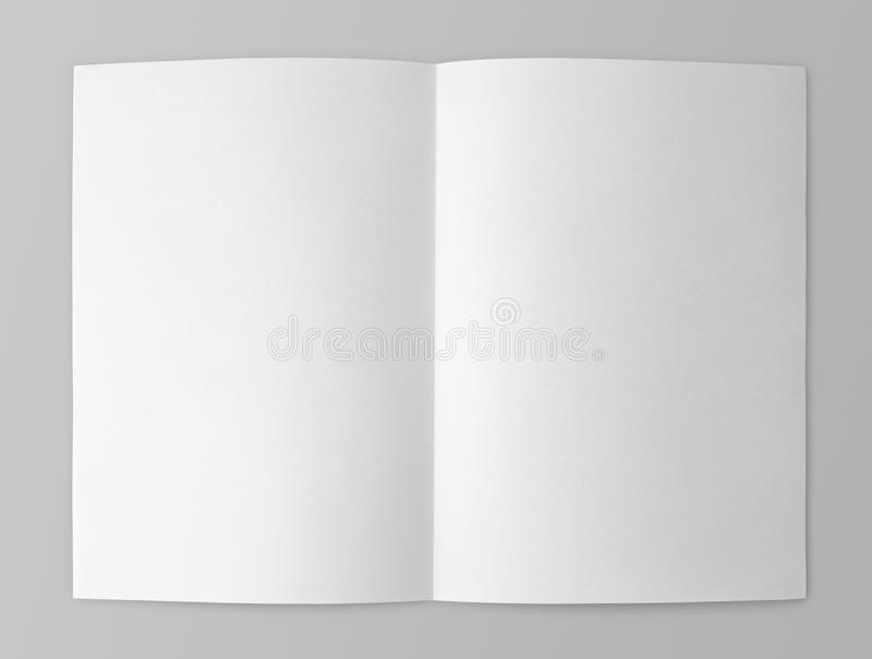 Blank folded flyer on gray stock photos