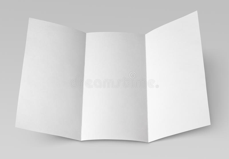 Blank folded flyer on gray. Empty window fold flyer isolated on gray with clipping path royalty free stock image