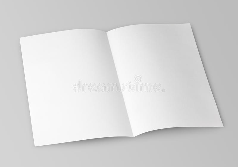 Blank folded flyer on gray. Blank folded flyer isolated on gray with clipping path royalty free stock images