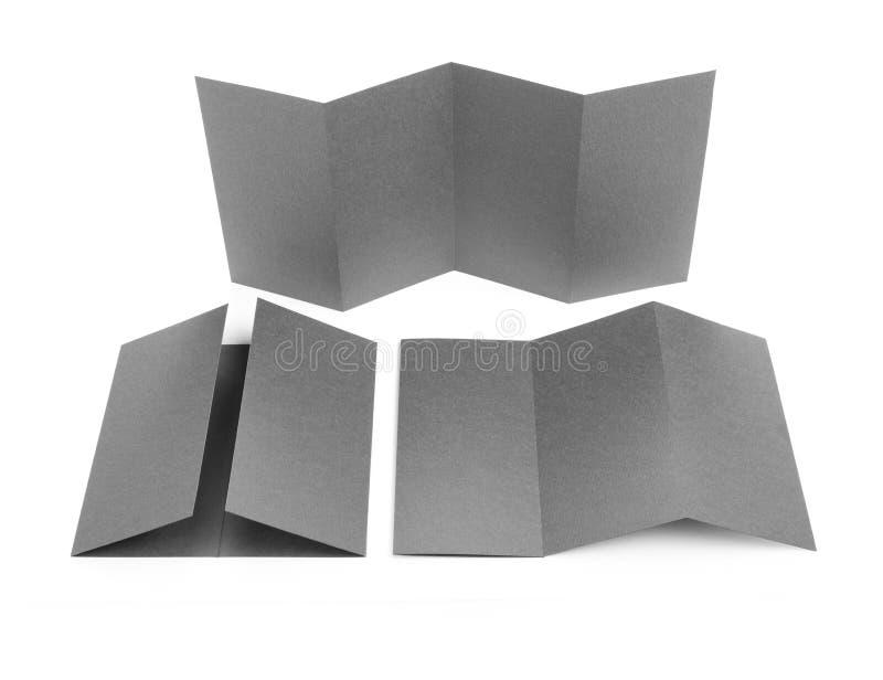 Blank folded paper leaflet or flyer mockup. stock images