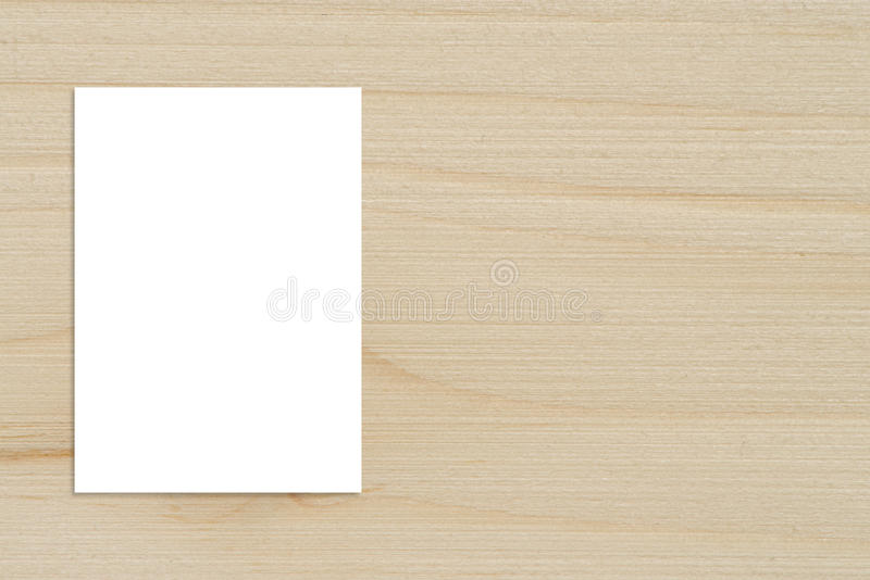 Blank folded paper poster hanging on wooden wall,Template mockup for adding your design. royalty free stock images