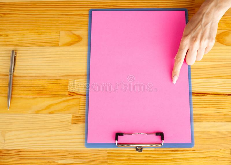 Blank Folder with Yellow Paper. Hand that Holding Folder and Han stock photos