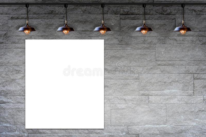 Blank frame on Granite stone decorative brick wall with lamp. For information message stock photos