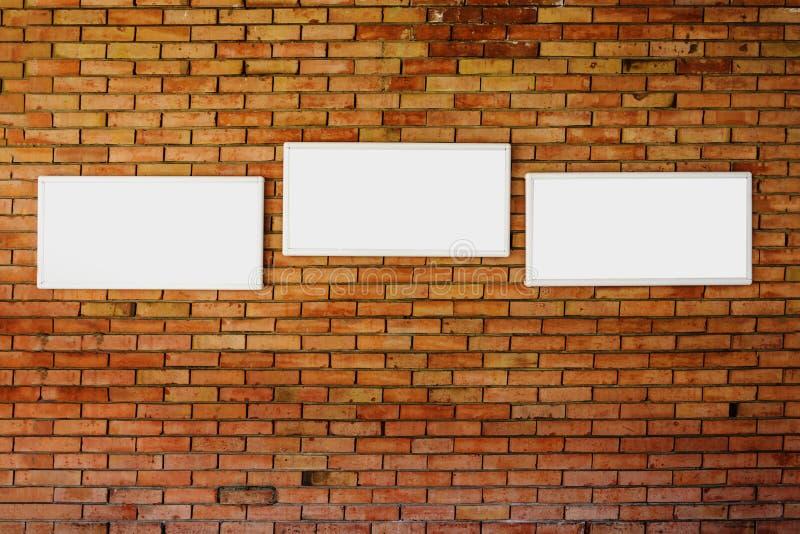 3 blank frame mock up on a brick wall. stock photos