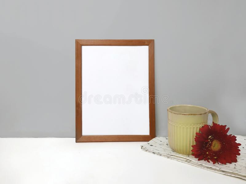 Blank frame mockup on table over stone wall stock images