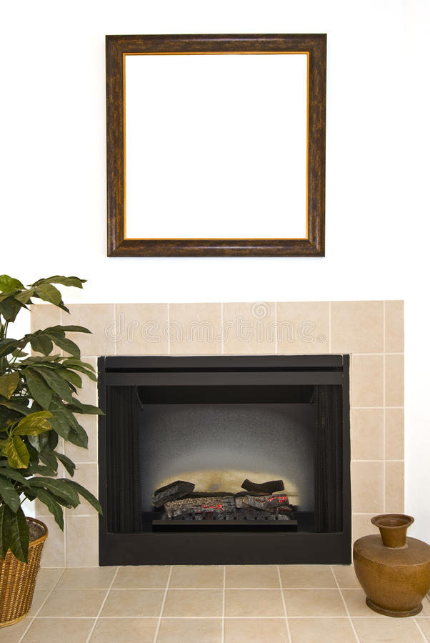 Blank Frame Over Fireplace. A blank frame hangs over a beautiful fireplace in an apartment stock photography