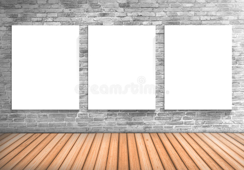 Blank frame three white board on a concrete blick wall and wooden floor : fill text and object royalty free stock photos