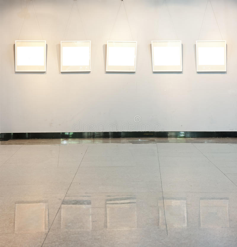 Blank frame on the wall at art gallery royalty free stock image