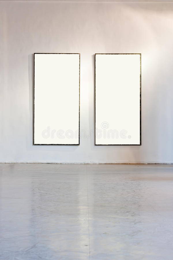 Blank frame on the wall at art gallery stock images