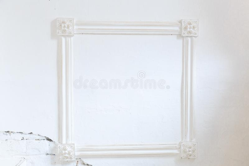 Blank frame on white wall. stock image