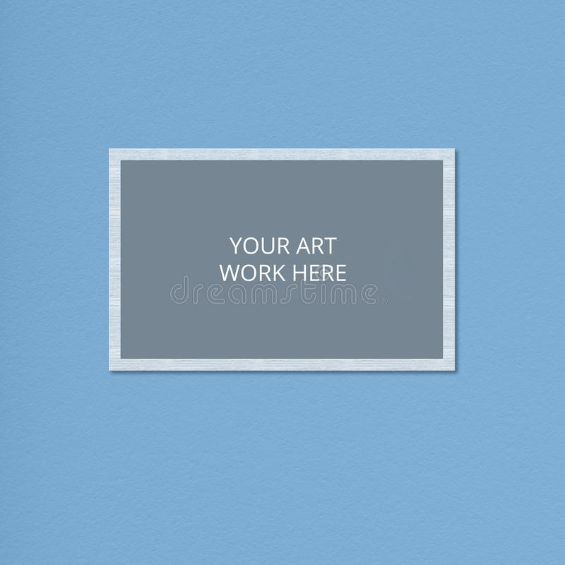Blank frame for your artwork or masterpiece against blue background. Empty space. Mockup frame. Horizontal shot royalty free stock image