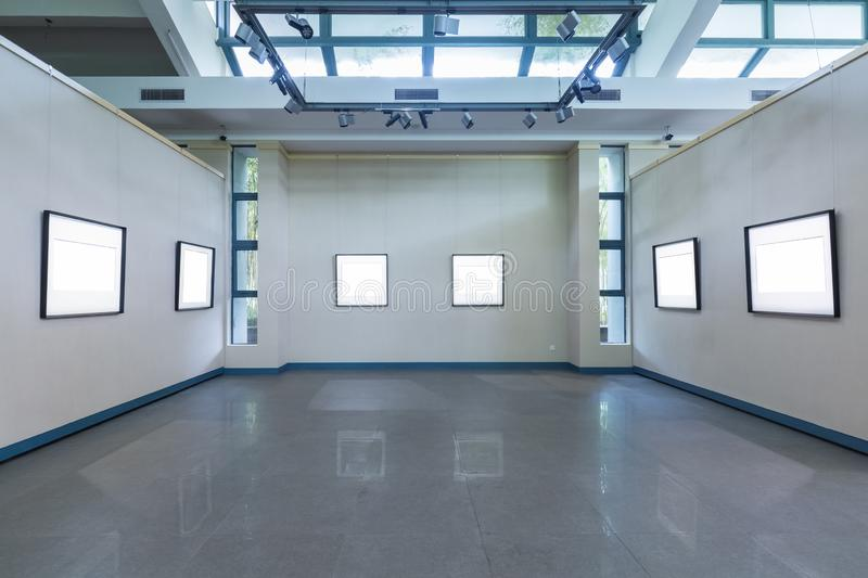 Blank frames on exhibition room. Fro painting or photography on wall, clipping path included stock photography