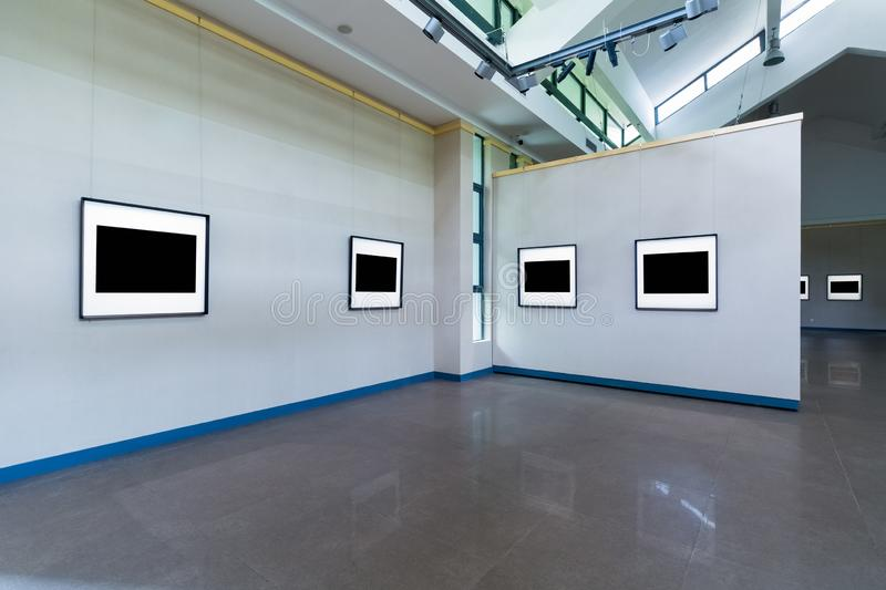 Blank frames on exhibition room. Fro painting or photography on wall, clipping path included royalty free stock photography