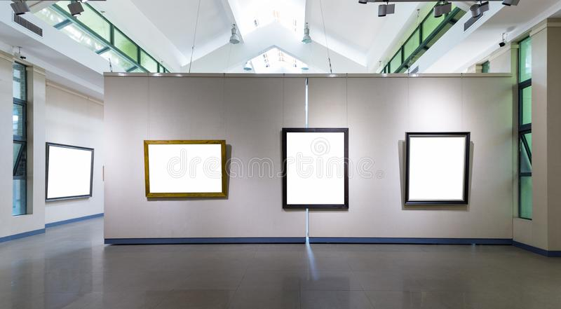 Blank frames on exhibition wall in a room. Blank frames fro painting or photography on exhibition wall in a room stock image