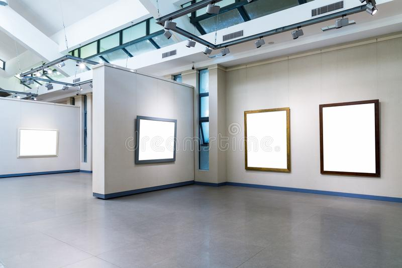Blank frames on exhibition wall in a room. Blank frames fro painting or photography on exhibition wall in a room stock photo